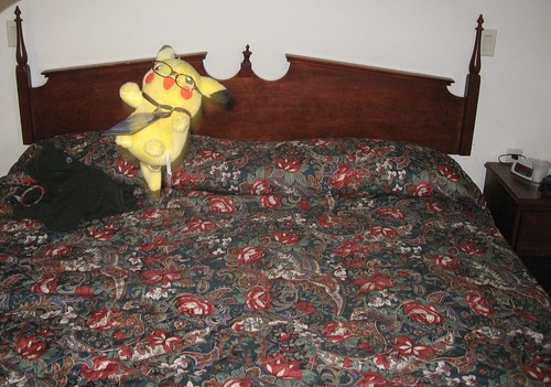 Pikachu jumping on the bed