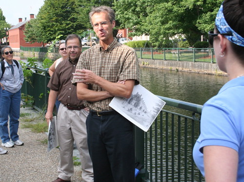 Gray Fitzsimons leads teachers on a historical walking tour of Lowell