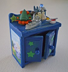 A Little Boys Enchanted Toy Cabinet ~1:12th Scale (Enchanticals~ Death in Family) Tags: wood blue boy food dog green dogs nature lamp car yellow pine kids truck paper children airplane stars fun toy toys miniature artwork doll ship play purple cabinet furniture handmade feathers vessel spoon plastic collectible jello rement littleboy homedecor dollhouse dioramas littlethings playthings feltedwool oneinchscale toycabinet roomboxes 112thscale dollhouseminiature etsyartists etsyteams minimakers dontmakeascene miniaturedoors damteam teammids enchanticals miniaturedollhousescale minitreasures enchanticalsetsy dollhouseitem miniaturesindollhousescale miniaturecollector 112scaledollhousescale addictedtominis alteredboxesminiatures 112thscaleonetwelfthscale boatmetal