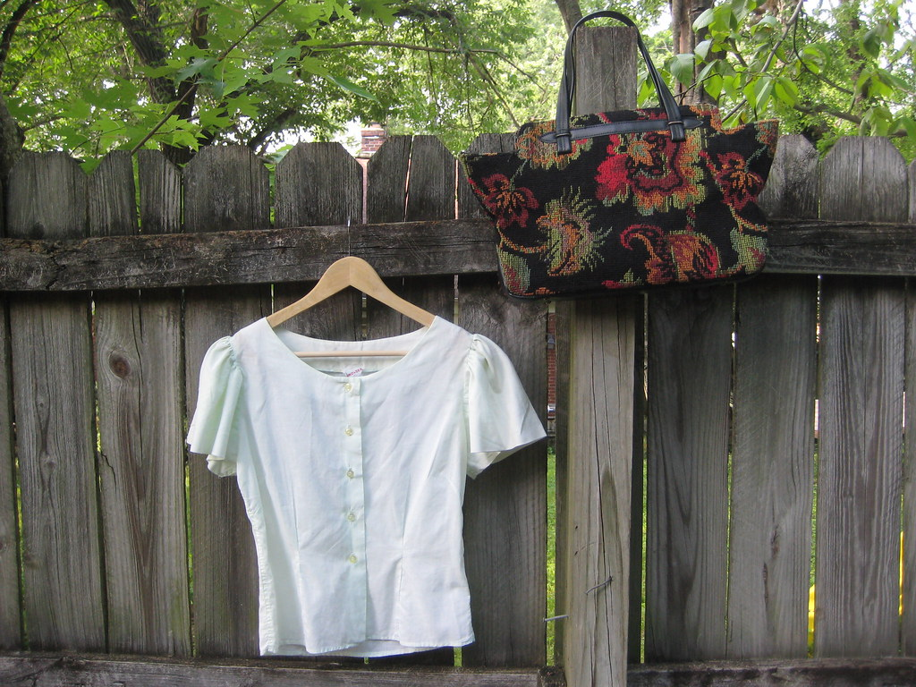 carpet bags and mint green blouses