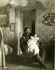 Man and Child in Rocker (depthandtime) Tags: old wallpaper man wisconsin vintage found child snapshot rocker northern photoofphoto foundphoto photocollage damask foundimage unmounted