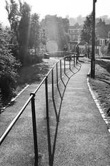 The Ladder? (pigsinspaces) Tags: street light shadow summer blackandwhite bw june dark lens scotland edinburgh candid pedestrian flare castiron stockbridge banister railing 2010 saxecoburgplace