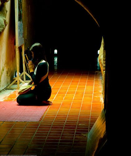 Woman praying at Wat Umong, Chiang Mai