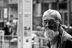 :-) (Gregor Winter) Tags: life street old winter portrait people bw white man black berlin male blanco canon mouth germany hair beard happy photography 350d glasses eyes europe raw day mood expression unique candid negro grain bad streetphotography documentary streetlife excited bn amish german lucky wierd angry friendly moment noise amused nois iro regen gregor frime friedrichstrasse mullah decisive dud docu grimy armish 123bw bwart8sep