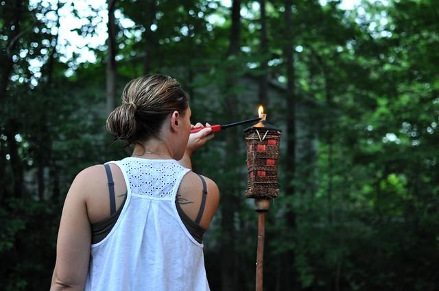Sara lighting the torch