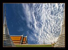 In Between Spires (DanielKHC) Tags: roof sky clouds thailand temple bravo spires bangkok sony alpha wat a100 magicdonkey abigfave artlibre danielcheong holidaysvancanzeurlaub goldenphotographer danielkhc nearwatarun