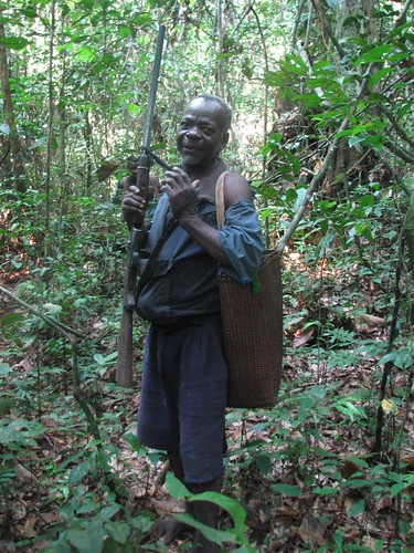 A local hunter and his shotgun in the Lomami Lualaba forest