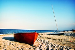 alla deriva (morning lord) Tags: blue light sunset red sea summer sky beach contrast boats sand tramonto mare shadows estate bright blu peaceful barche ombre cielo pace rosso calabria spiaggia luce vacanze soverato 2007 sabbia contrasto intenso isawyoufirst morninglord davidegreco