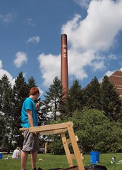 Field School Student screens in the shadow of the MAC smoke stack
