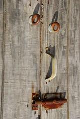 smile, please! (trAvelpig) Tags: door wood face handle newjersey rust lock nj photodomino wharf capemay d200 gardenstate travelpiginterestingness photodomino474