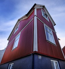 The Five-Dimensional Barn (Stuck in Customs) Tags: pictures lighting blue light red wallpaper panorama house art texture colors beautiful lines architecture modern composition barn work reflections painting fun photography iceland amazing cool intense nikon perfect exposure shoot artist mood photographer shot angle bright photos farm vibrant unique background details d2x perspective surreal atmosphere images best reykjavik edge processing stunning pro framing lovely capture emotions tones magical hdr masterpiece treatment mostviewed highquality stuckincustoms treyratcliff