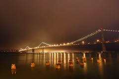 The Bay Bridge, from the Embarcadero (Tyler Westcott) Tags: sanfrancisco california longexposure bridge light reflection water night pier explore baybridge embarcadero yerbabeunaisland sfchronicle96hrs nikond40