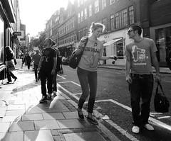 Life's a Slogan (Ian Brumpton) Tags: street bw noiretblanc candid londres westend londonstreetphotography aimlessstrolling blackwhiteheartbeats lifesaslogan