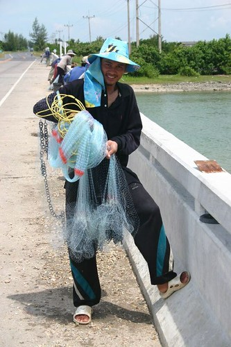 """Bridge fisherman"" with his net."