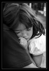 Shyness (ReneYoshi) Tags: blackandwhite bw canon asian rebel holding shy littlegirl 24105mm xti 400d bwphotoaward