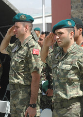 Two Turkish soldiers salute (NATO Training Mission-Afghanistan) Tags: afghanistan turkey war peace ceremony afghan donation supplies signing kabul ntma2010
