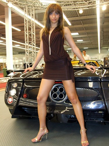 Beautiful brunette in black dress at Luxury car show