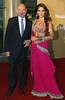Actors Ben Kingsley, left, and Bipasha Basu stop on the red carpet for photographers while on the way to the New Seven Wonders of the World official declaration ceremony Saturday, July 7 2007 at Luz stadium in Lisbon, Portugal.
