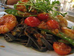 squid ink pasta with prawns and sugar snap peas