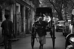 DSC_0405 (Tanja on flikr) Tags: 2005 street bw india children rickshaw kolkata puller westbengal black38white
