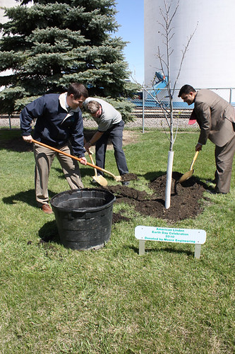 North Dakota Rural Development State Director Jasper Schneider (left) shovels during a tree planting ceremony celebrating Earth Day 2010, in Finley, ND. Assisting are Finley Mayor Larry Amundson (center) and Special Assistant for Rural Utilities John Padalino (right).