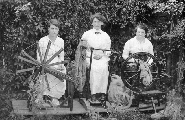 Three women spinning wool to knit socks for soldiers during World War I - Tenterfield, NSW, ca. 1915 / photographer unknown