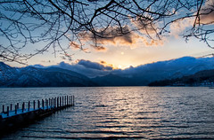 The Lake at Nikko (Stuck in Customs) Tags: world travel sky cloud sun mountain lake cold water japan photography blog high asia dynamic stuck natural scenic freezing photograph april vista nikko range hdr trey tochigi kanto travelblog customs 2010 honshu  nikk ratcliff  tochigiprefecture tochigiken honsh nikkshi hdrtutorial stuckincustoms  treyratcliff kant kantchih photographyblog stuckincustomscom nikond3x