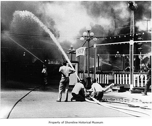 Playland fire with firefighters battling the Old Mill blaze, Bitter Lake, August 20, 1953
