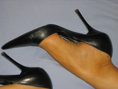 Sara's high arches and well worn pumps (al_garcia) Tags: feet high shoes sandals arches worn heel smelly