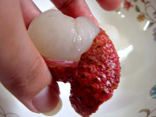 Peeling a lychee