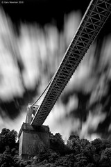 S u s p e n s i o n (Gary Newman) Tags: uk longexposure bridge trees england bw bristol below underneath cliftonsuspensionbridge bigstopper verticalbristol