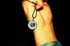 (Jaime_Elizabeth) Tags: travel saint plane flight icon charm chain fist denim wrinkle superstition patron stchristopher