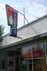 Old laundromat, tagged with graffiti. Photo by Laura Hadden -- thanks!