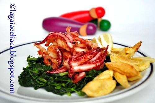 frittura di totani e gamberi su letto di spinaci selvatici