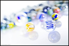 marble collection (Jon Downs) Tags: blue light red orange brown black color colour macro reflection green art glass field yellow closeup digital canon downs eos photo jon flickr artist glow dof bright image picture illumination experiment halo pic ring reflect photograph 7d marbles marble illuminate flickraward macromondays jondowns