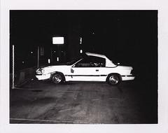 White car / Polaroid 107 - Untitled-35_72dpi (kevindean) Tags: auto blackandwhite bw white film car polaroid crashed pack instant smashed damaged 107 peelapart