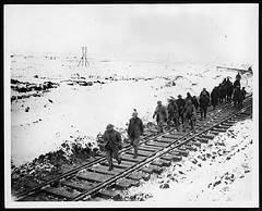 Marching along a railway track (National Library of Scotland) Tags: winter snow france cold walking war track mud propaganda wwi great tracks photojournalism railway worldwari marching worldwarone soldiers ww1 greatwar railwaytrack firstworldwar muddy troops flanders railroadtracks sleepers thegreatwar 19141918 warphotography photographicprints nls:dodprojectid=74462370 organization:library=nationallibraryofscotland owner:name=nationallibraryofscotland nls:source=solrxml blackandwhiteprintsphotographs worldwar19141918campaignswesternfront snowprecipitation nls:dodid=74548066 nls:derivative=74406506
