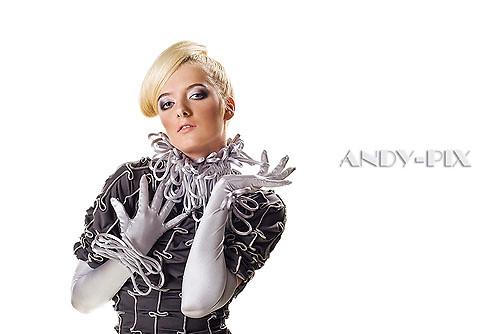 fashion model in a stylish gray dress