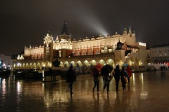 Walking in the rain  (~Ranveig Marie~) Tags: street city light vacation people reflection building wet rain weather architecture night walking poland polska tourist unesco dailylife minor krakw cracow oldtown polonia touristattraction gamlebyen attraction worldheritage markethall maopolska staremiasto rynekgwny lesserpoland