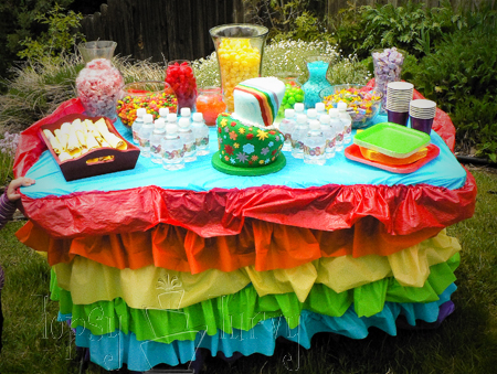 rainbow garden birthday party ruffles table skirt candy bar cake