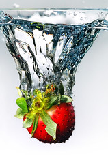 A drop of Freshness (Herman Au - http://www.hermanau.com) Tags: water fruit speed strawberry bravo flash fast drop fresh shutter splash highspeed abigfave impressedbeauty superaplus aplusphoto diamondclassphotographer flickrdiamond superhearts hermanauphotography