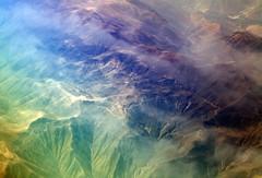 Andes, from plane window #1 (Peru) - by Luke Redmond