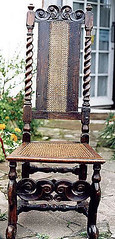 Antique chair with caned panel on the back