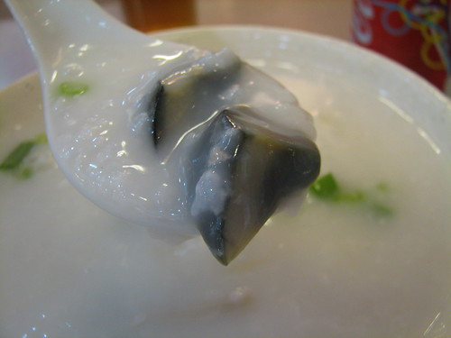 preserved egg and salty meat (pork) congee