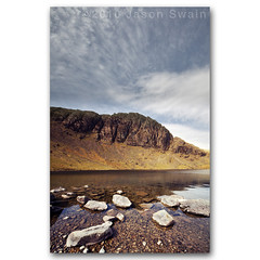Stickle Tarn & Pavey Ark, Lake District, UK. (s0ulsurfing) Tags: pictures uk blue england sky panorama cloud mountain lake mountains reflection english nature water clouds composition canon walking landscape photography blog still scenery rocks skies natural britain hiking district wide perspective lakes picture clarity wideangle panoramic calm hills reflected photograph valley cumbria fells serenity 7d april vista pikes british serene landschaft stillness foreground langdale cirrus 2010 treking langdales stickle 10mm paveyark sigma1020 harrisonstickle s0ulsurfing whataplace vertorama canon7d