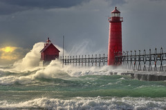 """The Storm"" Grand Haven Lighthouse , Grand Haven Michigan (Michigan Nut) Tags: sunset usa lighthouse seascape storm green art beach nature clouds landscape geotagged photography waves lakemichigan splash recent sunray grandhavenmichigan frontpageexplore d700"