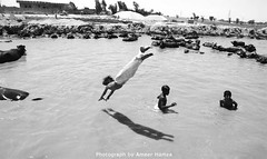 Life: Diver kids (Ameer Hamza) Tags: trip travel pakistan summer bw white black game sports sport contrast relax crazy divers tour dive floating games tourists madina heat float 50 dives sind sindh hamza summers ameer 50c scoopt ameerhamza sindhis lpshade