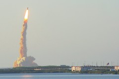 Shuttle Atlantis Evening Launch (jkc photos) Tags: camera sky usa cloud blur building bird beach water closeup digital america canon buildings advertising geotagged fire photography coast fly photo amazing cool flickr contrail afternoon close view unitedstates angle florida dusk sale map or space smoke air united flames stock flight engine center location adventure flame telephoto american agency shuttle atlas cape rocket states cooler ksc launch cocoa sell exploration geotag 75300 purchase kennedy coordinates soar canaveral distant fotolia manned e20ci sts117
