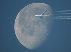 Moon Shot 2 (jpro747) Tags: travel blue sky moon topf25 interestingness high bravo contrail photographer crossing cross traffic path 10 top altitude air flight jet clear explore telescope airline airbus excellent lh awards lufthansa overhead vapour dlh a340 deutsche telescopic crossover a343 inthesky overflight seenonexplore anawesomeshot impressedbeauty superbmasterpiece diamondclassphotographer excellentphotographerawards jpro747