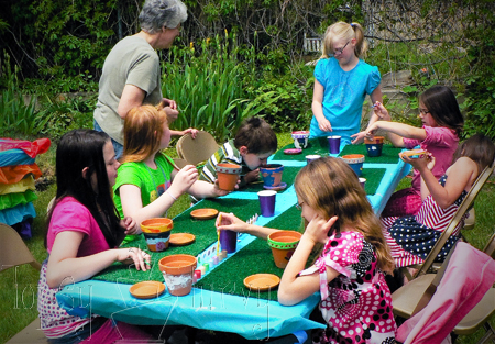 rainbow garden birthday party girls making crafts painting